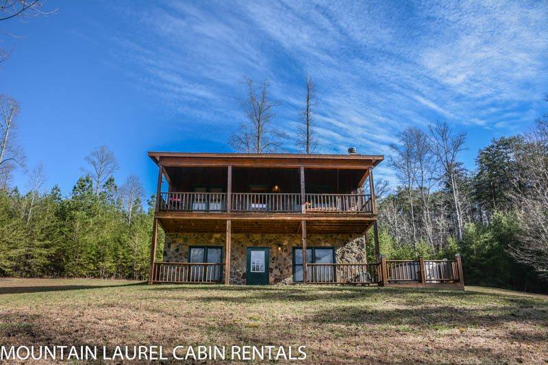 KINGDOM CABIN #2- 3BR/2BA- TOTALLY SECLUDED CABIN WITH CREEK SLEEPS 8, HOT TUB, CHARCOAL GRILL, FIREPLACE, FIRE PIT, AND PET FRIENDLY! STARTING AT $99/NIGHT! - Image 1 - Blue Ridge - rentals