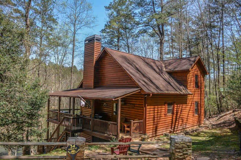 R&R; RIVER RETREAT- 4BR/3BA, HOT TUB, 6 MAN SAUNA, 315 FT RIVER FRONTAGE, FOOSBALL,WET BAR,SAT TV, WOOD BURNING FIREPLACE PLUS ALL RESORT AMENITIES. PETS ARE WELCOME, SLEEPS 12 & STARTS AT $190 PER NIGHT - Image 1 - Blue Ridge - rentals