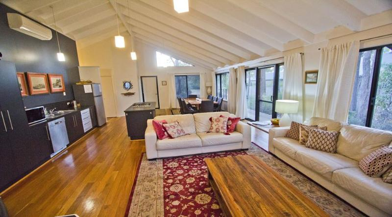 Open plan living. Leather lounges, pot belly and air conditioner - Boulevard - 20% off for new 5+ night bookings for January 2017 - Margaret River - rentals