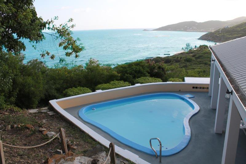 Looking out to Grapetree Bay, from above the pool. - Grapetree Escape: St. Croix, US Virgin Islands - Saint Croix - rentals