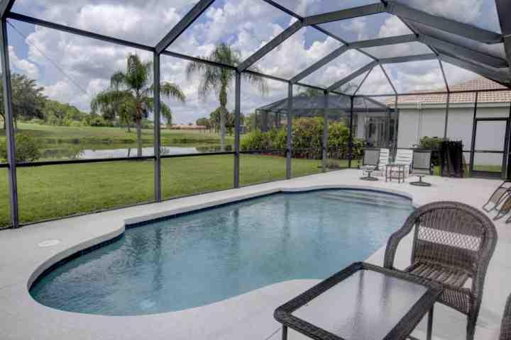 The refreshing sparkling pool area has plenty of seating and pool toys are here for your use - Heritage Harbour 4 bedroom pool home in gated golf community. - Bradenton - rentals