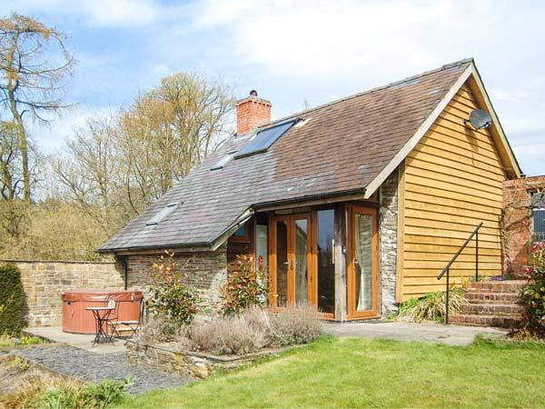 THE CWTCH, converted barn, super king-size bed, woodburner, hot tub - Image 1 - Llanbister - rentals