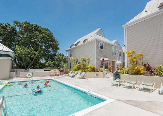 Large rooftop pool with sun deck and lounging areas  - Casa Bonita- Luxury Duval St. Condo w/ Shared Pool & Balcony - Key West - rentals