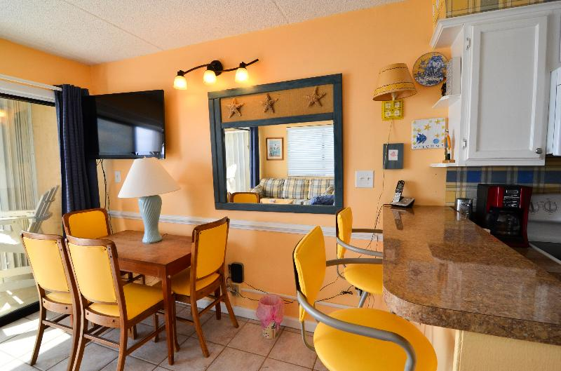 DINING AREA WITH BREAKFAST BAR - Cabana 232 2 Bedroom Oceanfront in Carolina Beach - Carolina Beach - rentals