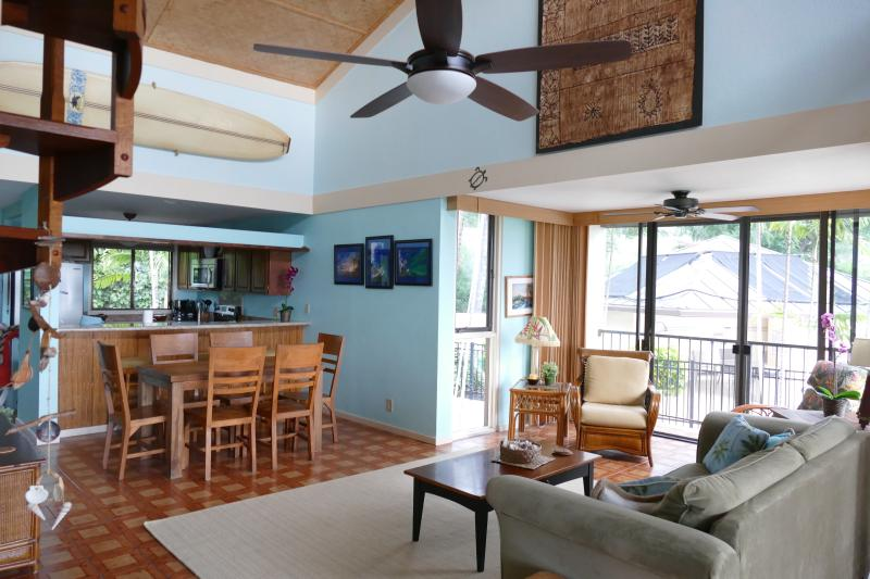 Living area and kitchen all have ocean and pool