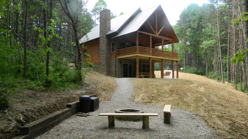 View of cabin from fire pit - Beautiful and Secluded Amish Built Log Cabin - Logan - rentals