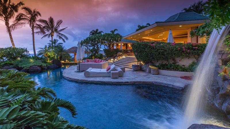 Beautiful waterfall feature and pool at twilight, jacuzzi grotto under the waterfall! - Fairways North #1: Hale Pau Hana Mauna Kea Resort - Kamuela - rentals