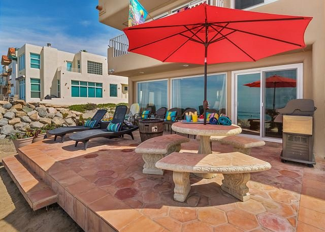 backyard patio  - Gorgeous Single Family Beachfront Home on the Sand, Equipped with A/C - Oceanside - rentals