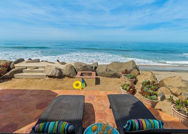 backyard patio with beach view  - Gorgeous Single Family Beachfront Home on the Sand, Equipped with Central AC - Oceanside - rentals