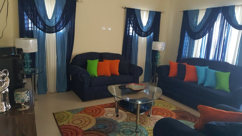 Living Room with Wifi, Cable, Stereo, Flat Screen TV - Sunny Escape Villa - Ocho Rios - rentals