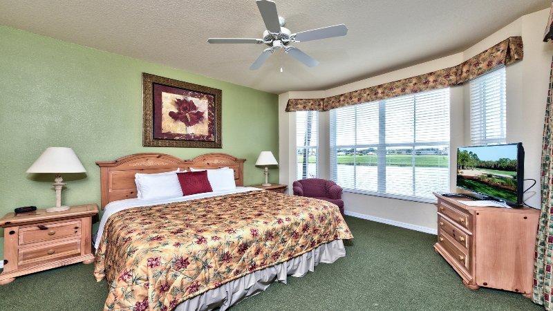 Master Bedroom with Flat Screen TV, Fan, and Lake and Golf Views; Private Entrance to the Lanai Area; Unrivaled Golf Resort Location! - Sienna 1st Floor Golf Condo at the Lely Resort - Naples - rentals