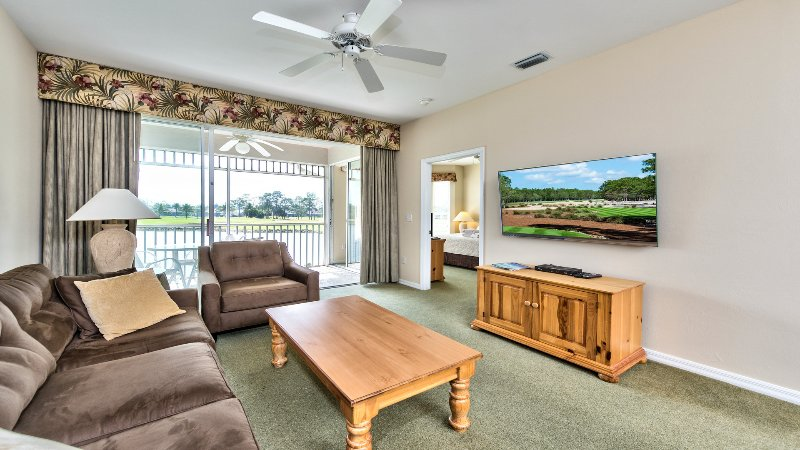 Living Room with Flat Screen TV, Fan, and Entrance to Lanai Area with Lake and Golf Views! - Solterra 2nd Floor Golf Condo at the Lely Resort - Naples - rentals
