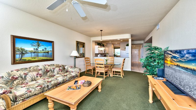 Living Room with Flat Screen TV, Fan, and Entrance to Lanai Area with Lake and Golf Views; Couch is a Pull Out! - Vicenza 1st Floor Golf Condo at the Lely Resort - Naples - rentals