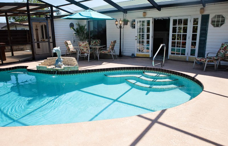 Pool side looking into patio and French doors - The Palms - 3 Bed/2.5 Bath, Pool,Hot Tub, Game Rm - Bradenton - rentals