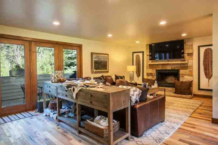 Living room with gas fireplace, large flat screen smart TV, deck access and comfortable yet stylish furnishings. - East Vail Duplex, Recently Remodeled! Private Hot Tub and easy bus access to Vail mountain. - Vail - rentals