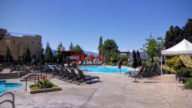 Licensed pool area with hot tub and lake views. - Waterfront Condo in Delta Grand Okanagan Resort - Kelowna - rentals