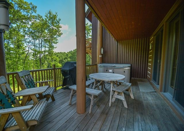 Deck - Astonishing 4 Bedroom Ski in/ Ski Out home with a bubbling outdoor hot tub! - McHenry - rentals