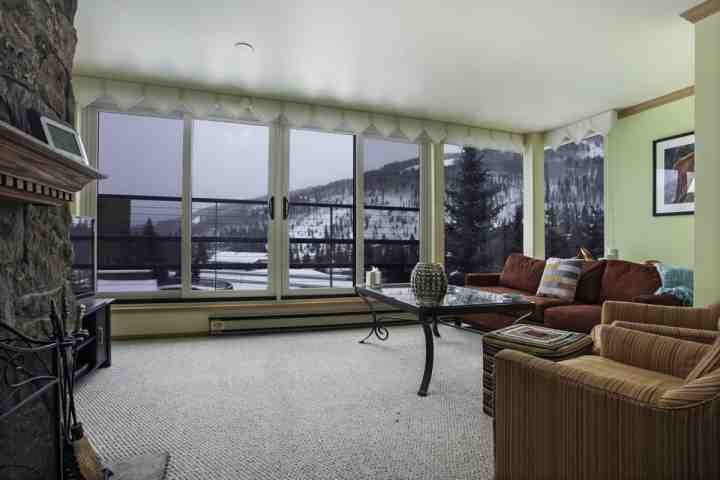 Relax in the living area with a woodburning fireplace, flat screen tv, DVD player and mountain views. - 5th FL Condo, Convenient to Town Bus Year Round or Free Shuttle Service in Winter, Pool & Hot Tubs! - Vail - rentals