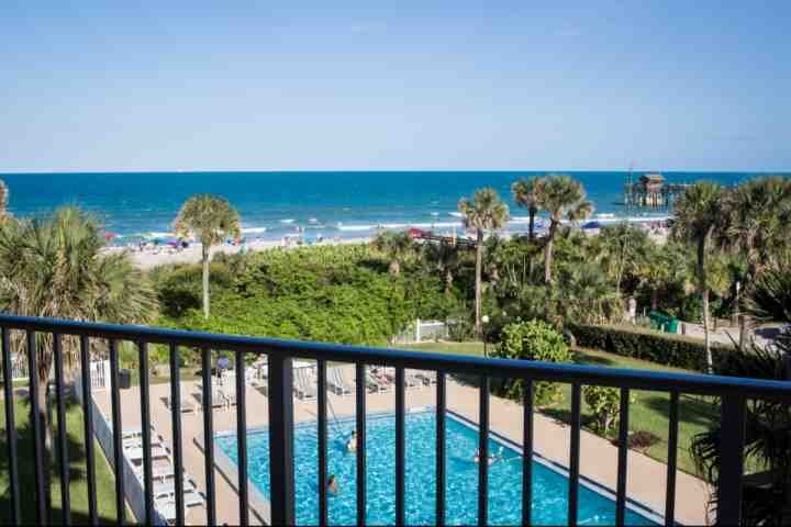 Pool view from balcony - **Summer Promo** Direct Ocean Views from this Updated Condo with Pool, Near - Cocoa Beach - rentals