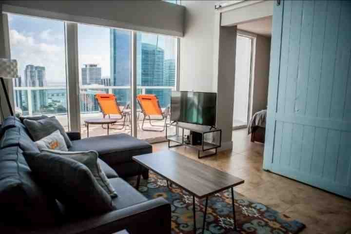 Modern style living room complete with an LCD TV. - 15% OFF PROMO - Luxury Waterfront Penthouse Loft in Upscale Brickell Complex - Miami - rentals