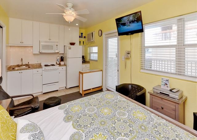 Queen size bed with seating areas and flat screen TV - Sea Rocket #26 - Updated 2nd Floor North Side Condo with Gulf View! Sleeps 4! - North Redington Beach - rentals