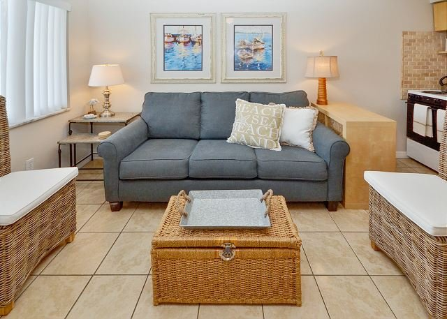 Living Room with Sleeper Sofa - Tropic Breezes #5 - Nice and Nautical! Ground Floor Poolside- Steps to Beach! - Madeira Beach - rentals