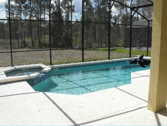 Stylish 5 Bedroom 4.5 Bath Pool Home in Watersong Resort. 621OCB - Image 1 - Davenport - rentals