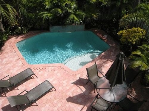 Lovely view off of the balcony of your private pool from the Master Bedroom! - Paradise Rental Retreats Casa by the Sea - Lauderdale by the Sea - rentals