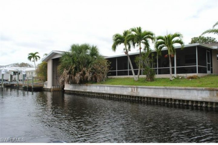 View of back of house from canal, large lanai, indoor boat lift. - Fisherman's Paradise - Bokeelia - rentals