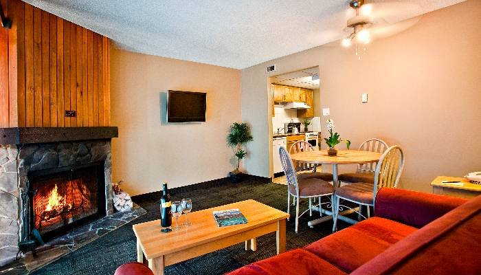 The living area of this condo is spacious and is decorated to feel like home - Banff Tunnel Mountain Resort Cozy Studio Condo - Banff - rentals