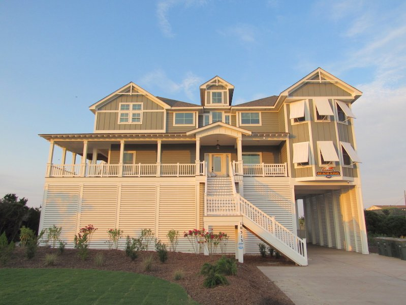 Beach King has a large wrap around porch and a wheelchair ramp under the porch. - Beach King - 9 BR Luxury Oceanfront Event Home - Nags Head - rentals