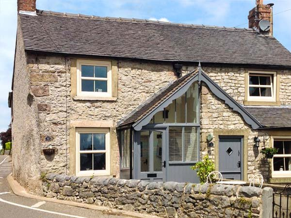 12 THE GREEN, romantic cottage, woodburning stove, patio with village views, en-suite, in Middleton Ref 16437 - Image 1 - Wirksworth - rentals