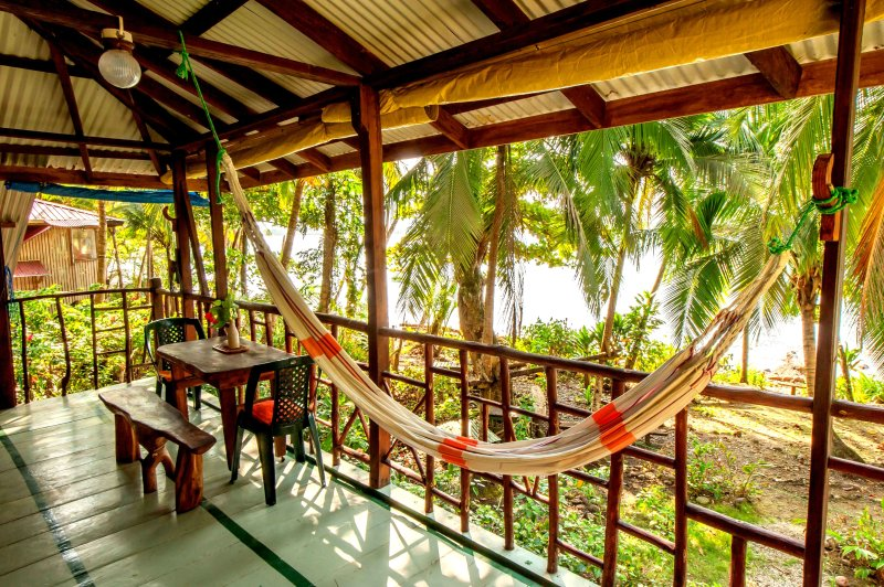lounging or dining on the balcony - CASA SERENITY BY THE SEA and pool - Isla Bastimentos - rentals