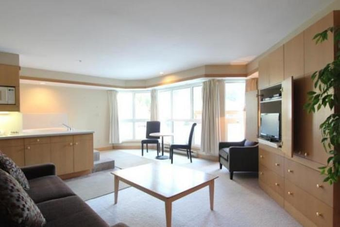 The studio suite includes a lovely living area with a TV - Whistler Le Chamois Cozy Studio Condo - perfect for a couple! - Whistler - rentals