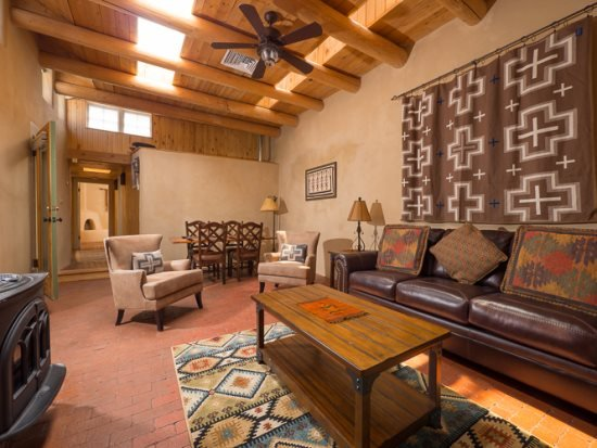 Prado- full view of living area featuring queen, sleeper sofa, flat screen TV and gas stove - Two Casitas - Prado - Historic, Hot Tub, in the Railyard - Santa Fe - rentals