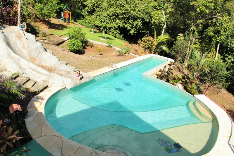 Pool with swim lane.  My two daughters are on the top/bottom of slide.  Jungle gym in background - The Family Jungle House - Quepos - rentals