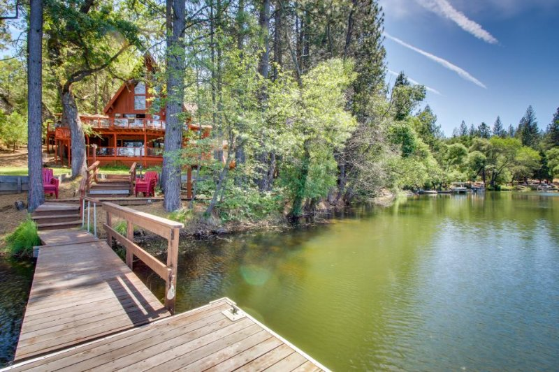 Dog-friendly lakefront home w/gorgeous chef's kitchen, private dock, shared pool - Image 1 - Groveland - rentals