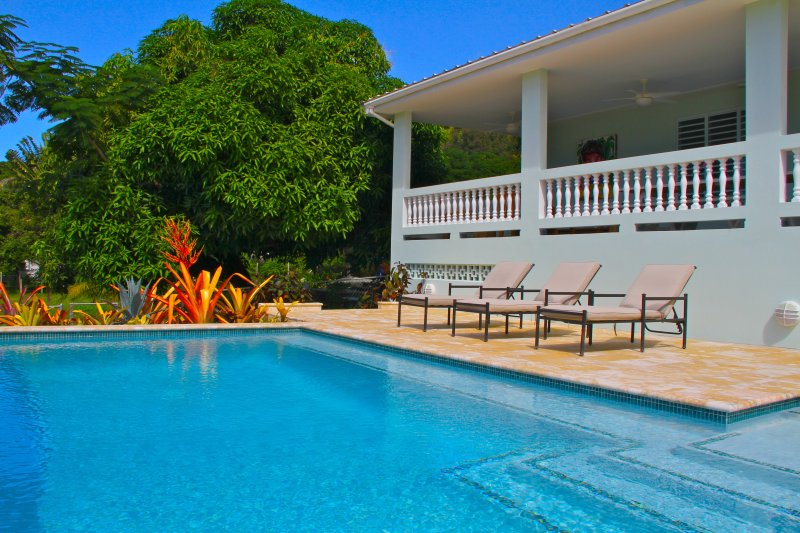 Back patio and pool deck facing Steps Beach.  Excellent sunset views. - R Villa at Steps Beach - Rincon - rentals