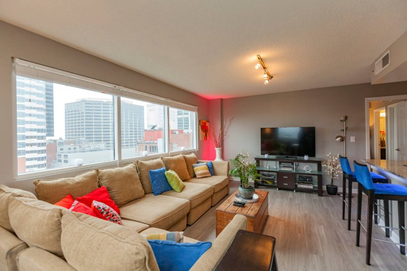 Relax with friends and family in the spacious living area - You Deserve an Upgrade with a View - Neon Lights of Lower Broadway at Your Doorstep - Nashville - rentals
