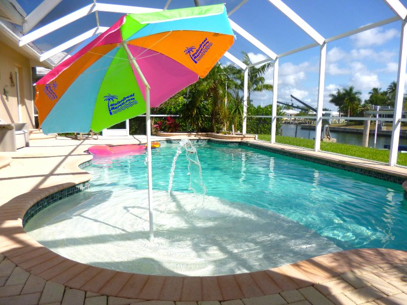 Waterfront Marco's awesome pool with fountain, umbrella, ledge and spa jets. - Waterfront Marco Family Weeks still open July/Aug - Marco Island - rentals