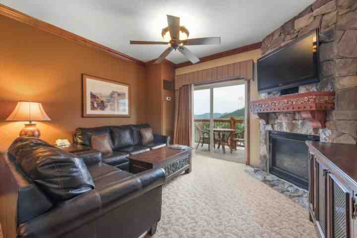 "The living room features two new leather couches, 54"" HDTV, enhanced cable, free Wi-Fi, stone mantle and floor to ceiling stone gas fireplace. - Westgate 1 Bedroom Suite Solace - Park City - rentals"