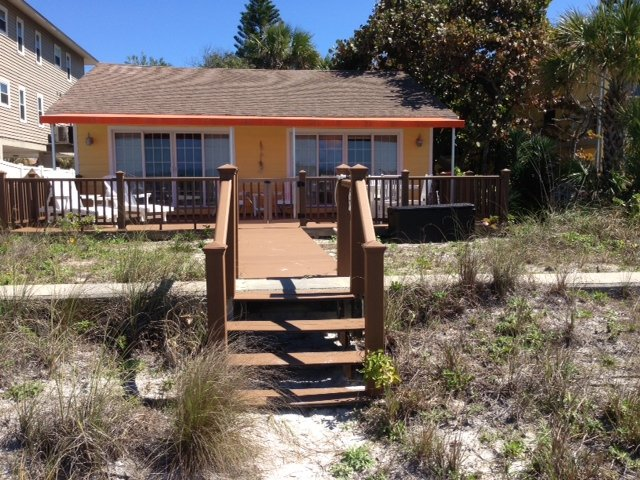 View from the beach.  Orange awning shades half the large deck! - Gulf Front Pet Friendly Beach Home - Indian Rocks Beach - rentals