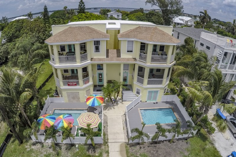The home is on the left.  We live on the right. - 5-STAR 4-BDRM 3-BATH PRIVATE HEATED POOL  ELEVATOR- Fall Special $350/night - Anna Maria Island - rentals