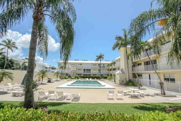 Pool Area+ BBQ Grill - Unit is on 2nd Floor...Relax among the Queen, Royal, & Coconut Palms! - Olde Naples 2nd Floor Condo- 3 Blocks to 5th Ave. and less than a mile to Beach! - Naples - rentals