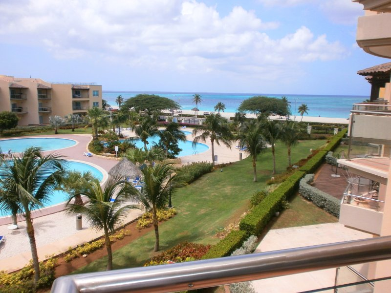 Your pool and ocean view from the balcony - Precious Ruby Two-bedroom condo - BC355 - Eagle Beach - rentals