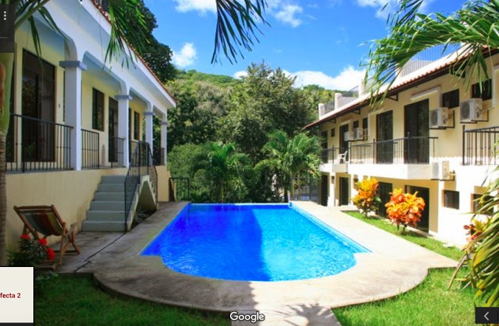 VP II courtyard view with swimming pool, our condo is the 1st door you can see on the left! - The Best Affordable Condo, Beautiful Ocean Views - Playas del Coco - rentals