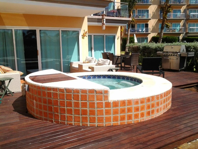 Large roman hot tub on your private decks in your garden! - Garden Delight Three-bedroom condo - E125 - Eagle Beach - rentals