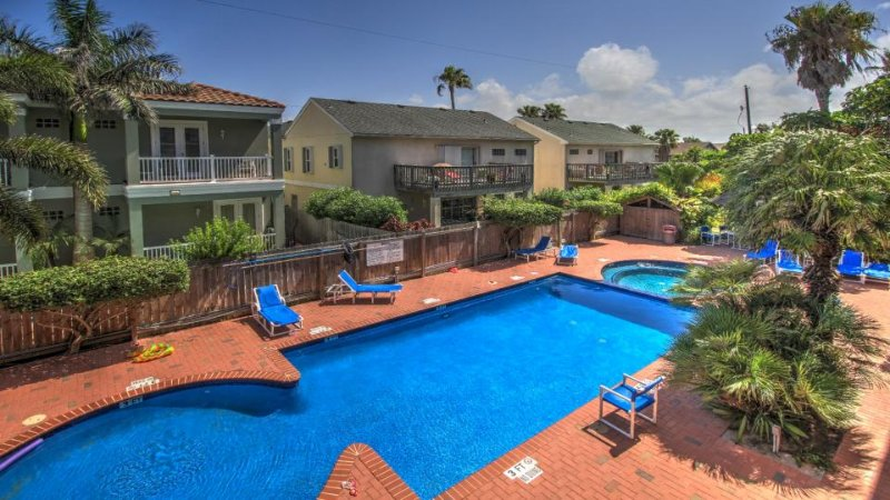 Spacious oasis near the beach w/ private balcony, shared pool & hot tub! - Image 1 - South Padre Island - rentals