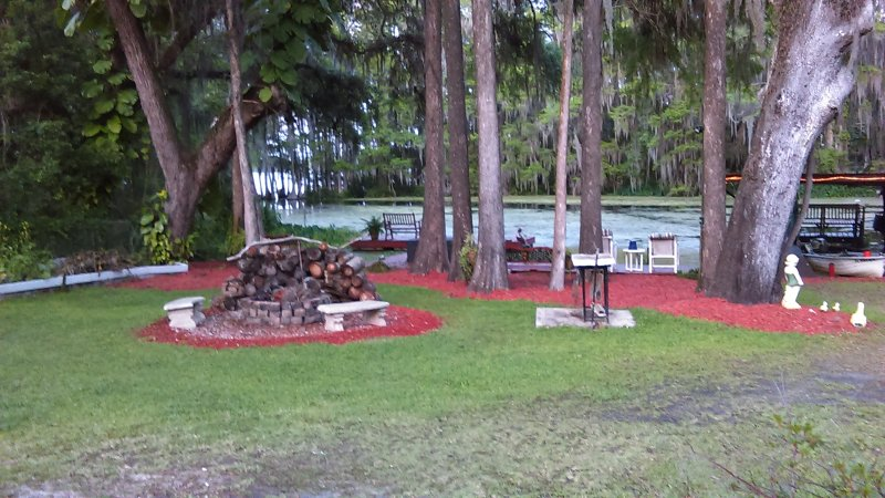 cove, fire pit, fish cleaner table, and one of the docks - Mom's River House..quiet n peaceful, canoes, docks - Crystal River - rentals