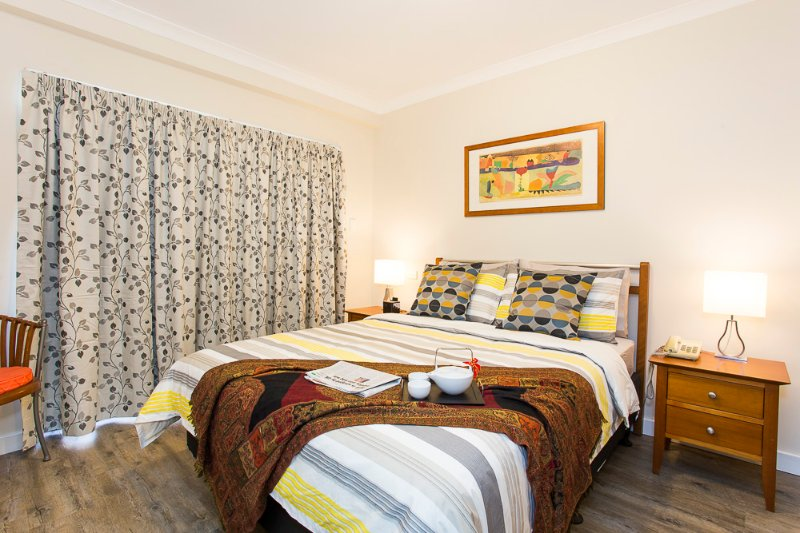 A comfortable queen-size bed for a relaxed slumber with blocked-out curtains - Istana Perth City - Free Secured Parking - Perth - rentals